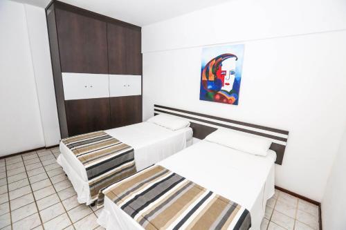 Cama ou camas em um quarto em Recife Flat Service