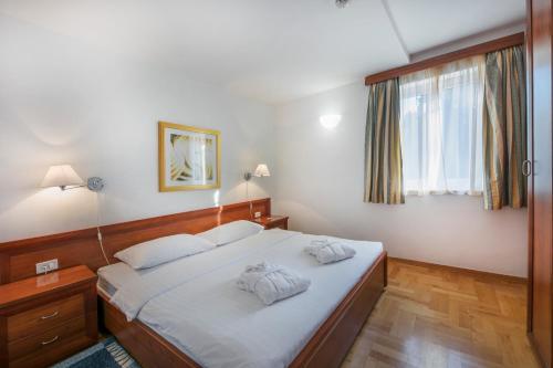 Ein Bett oder Betten in einem Zimmer der Unterkunft Apartments Punta