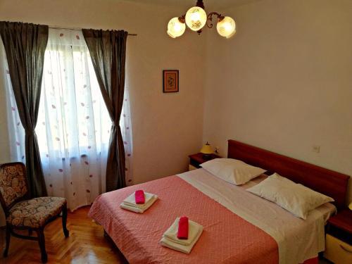 Postel nebo postele na pokoji v ubytování Apartmani Anda