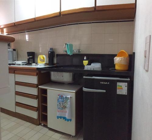 A kitchen or kitchenette at Passeios & Negócios Centro
