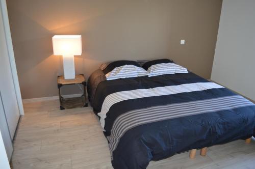 Un ou plusieurs lits dans un hébergement de l'établissement Gite De Blagny