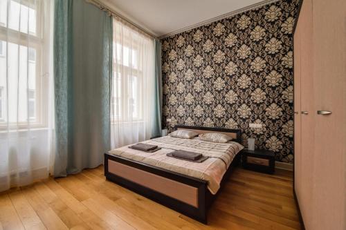 Een bed of bedden in een kamer bij AMAVI Černá Apartment