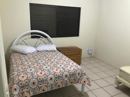 Cama o camas de una habitación en Casa Confortavel em Floripa