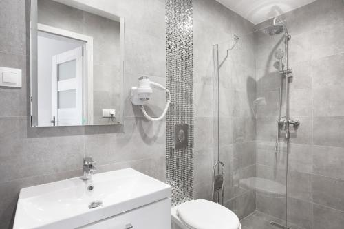 A bathroom at ZK by Happy 7 Apartments