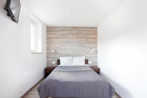 A bed or beds in a room at ZK by Happy 7 Apartments