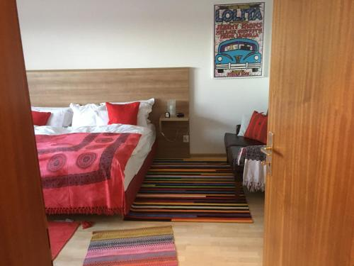 Ein Bett oder Betten in einem Zimmer der Unterkunft Zum Kupfermühlenberg