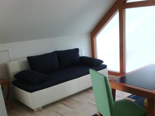 Ein Sitzbereich in der Unterkunft Ferienhaus Bauerngarten