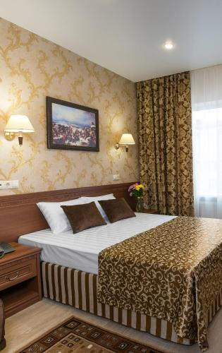 A bed or beds in a room at Suvorov Hotel