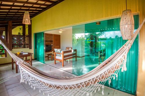 A piscina localizada em Imbassaí Breeze Apartamentos ou nos arredores