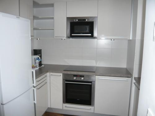 A kitchen or kitchenette at Bridgestreet Champs-Elysées Apartments