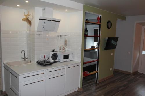 Кухня или мини-кухня в Northern Hope