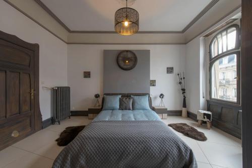 Ліжко або ліжка в номері L'appart Du Général