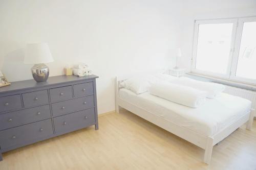 Ein Bett oder Betten in einem Zimmer der Unterkunft F10 APARTMENT Ulm