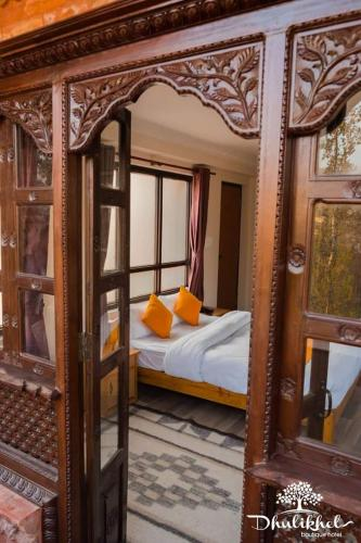 A bed or beds in a room at Dhulikhel boutique hotel