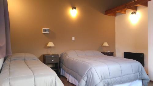 Postel nebo postele na pokoji v ubytování CONFLUENCIA - APARTS