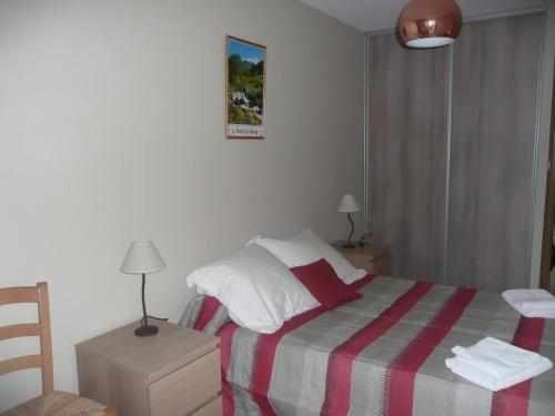 Un ou plusieurs lits dans un hébergement de l'établissement Residence L'Etoile du Sancy