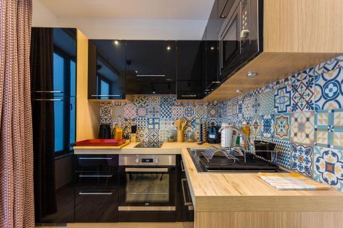 A kitchen or kitchenette at CMG Gambetta
