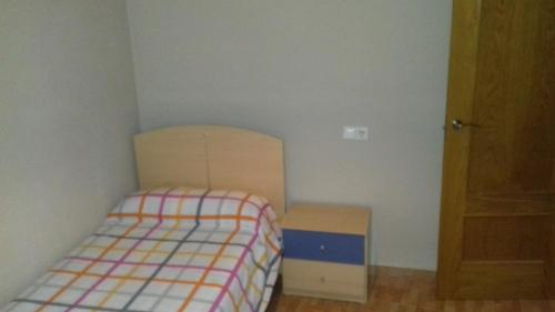 A bed or beds in a room at Piso Centrico En Linares