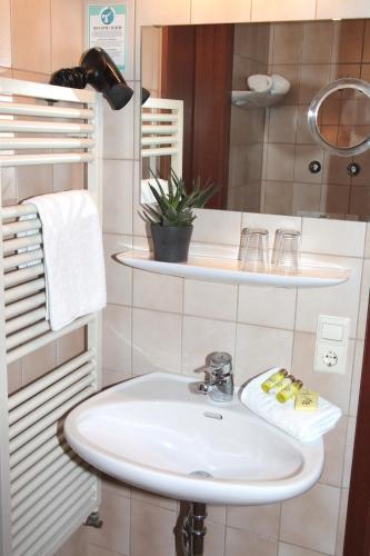 Ein Badezimmer in der Unterkunft Hotel an der Sonne