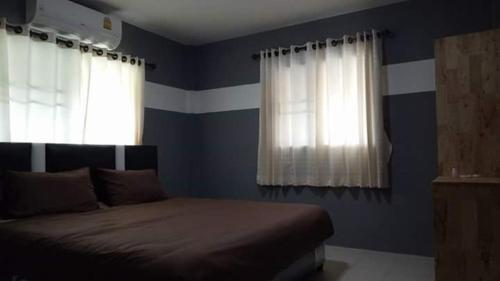 เตียงในห้องที่ Lotte Home
