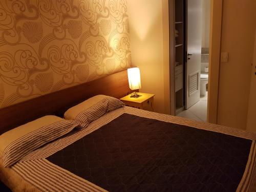 A bed or beds in a room at Landscape Beira Mar