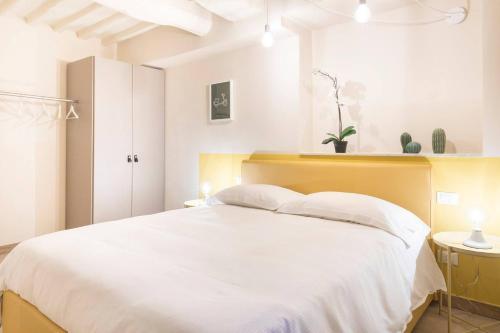 Cama ou camas em um quarto em Hintown Via Della Rosa