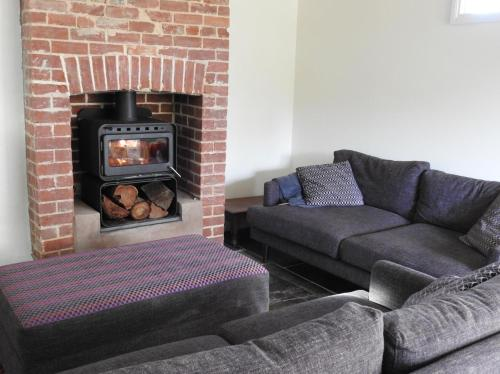 A seating area at Grape Pickers Cottage