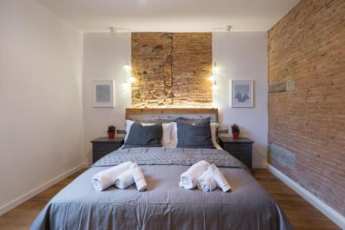 Een bed of bedden in een kamer bij La Gabbia del Grillo
