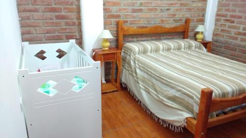 Una cama o camas en una habitación de Cuatro Estaciones