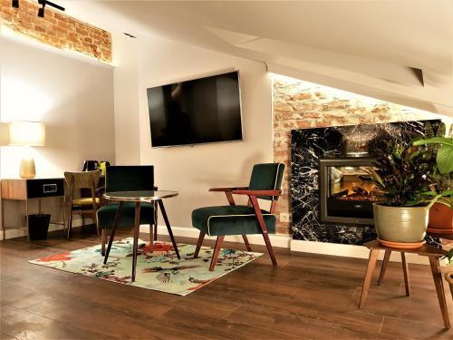 Telewizja i/lub zestaw kina domowego w obiekcie SleepWell Apartments Nowy Świat