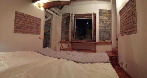 A bed or beds in a room at Tipica casa ligure