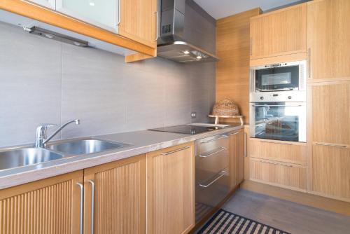 Een keuken of kitchenette bij App De Panne 2