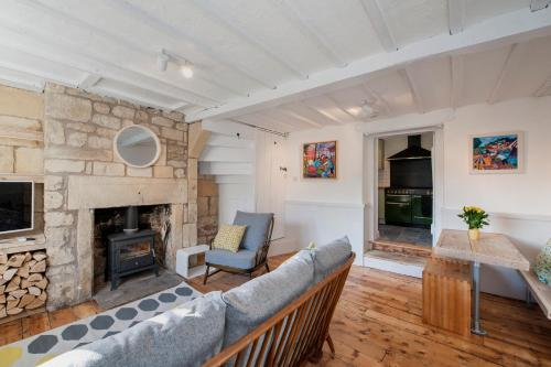 A seating area at Charming Period Cottage