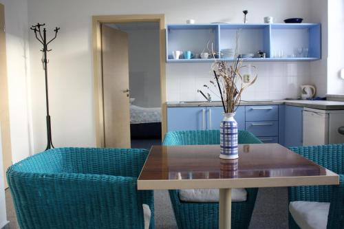 A kitchen or kitchenette at Apartmány Gulliver