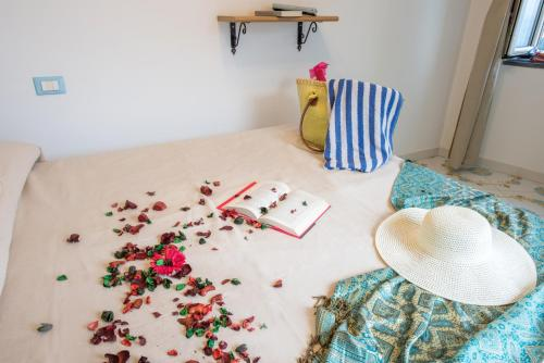 A bed or beds in a room at Ricciolo d'oro 1