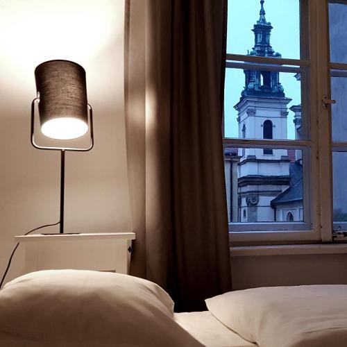 Posteľ alebo postele v izbe v ubytovaní Old Town Apart