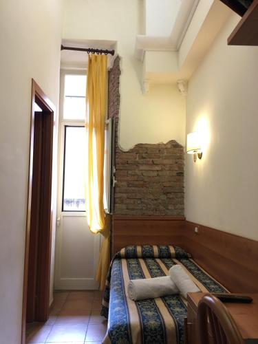 Letto o letti in una camera di Hotel Bolognese