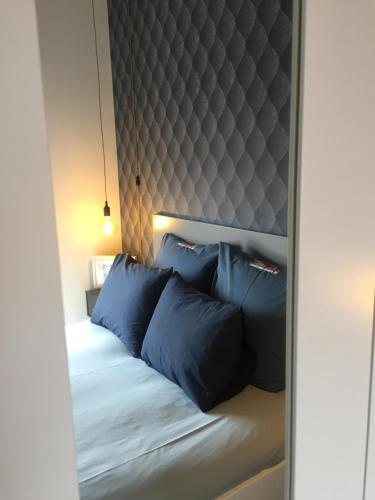 A bed or beds in a room at OPORTO GUEST Design Apartment Downtown