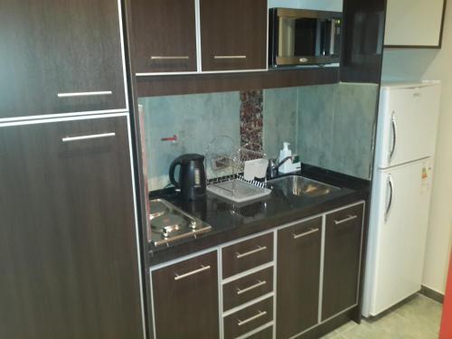 Una cocina o kitchenette en Alquileres Temporarios en San Juan