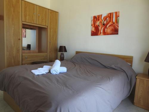Un ou plusieurs lits dans un hébergement de l'établissement Pelican Court