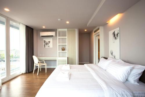 A bed or beds in a room at Kannas Serviced Apartment