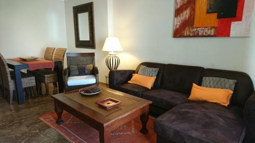 A seating area at Apartamentos Kasa25 Azaleas