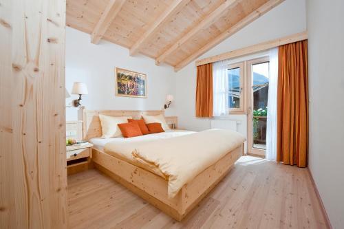 Ein Bett oder Betten in einem Zimmer der Unterkunft Brugger Dörfl
