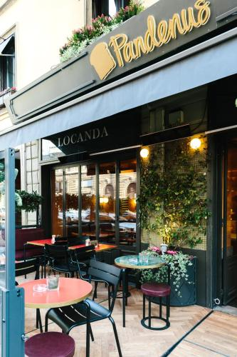 A restaurant or other place to eat at Locanda Pandenus Brera