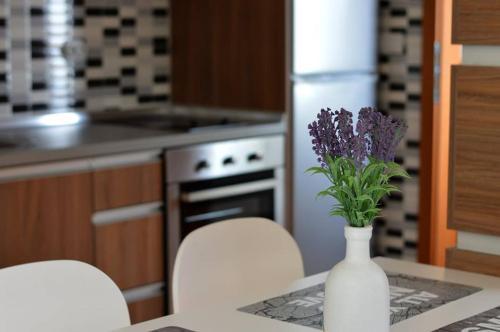 A kitchen or kitchenette at Korzo Apartments