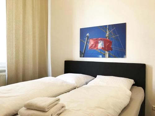 Ein Bett oder Betten in einem Zimmer der Unterkunft Appartements in der historischen Deichstrasse