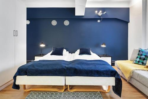 A bed or beds in a room at Forenom Serviced Apartments Oslo Central