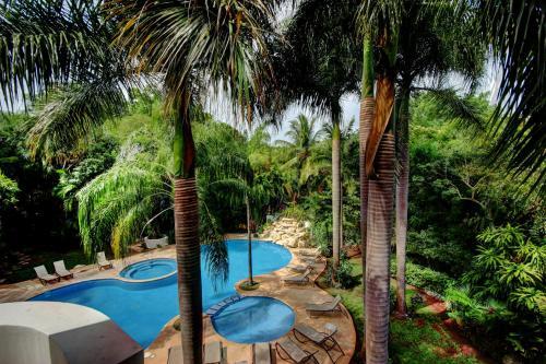 Vista de la piscina de Riviera Maya Suites o alrededores