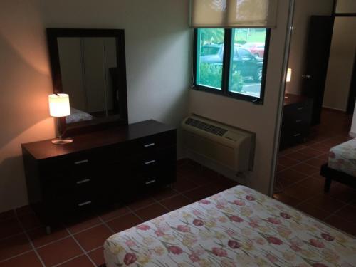 A television and/or entertainment center at Luxury Apartment - El Dorado Club