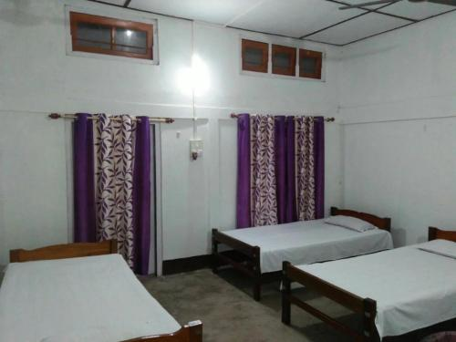 A bed or beds in a room at Subansiri Vacation Homes